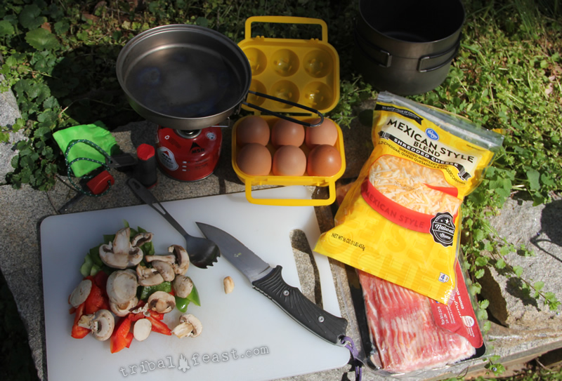 Cutting up vegetables to cook up a backcountry omelet.