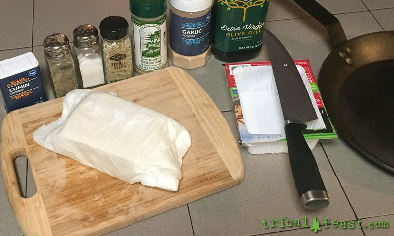 Wrapping the tofu in paper towel and gently pressing repeatedly by hand is a great way to lesson cook times and improve the texture.