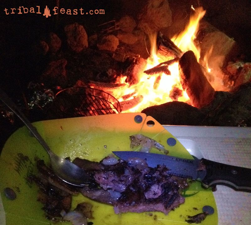 Tackling a steak by the campfire with a Gerber Big Rock Camp Knife