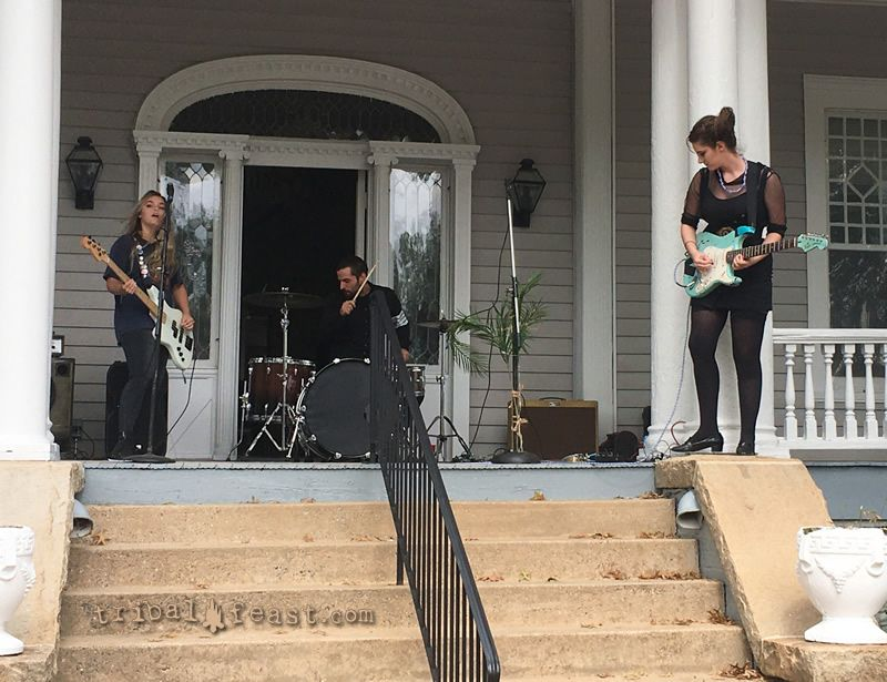 Monsoon plays on the front porch of the Flagpole Magazine headquarters at Athens Porchfest in Athens, GA.