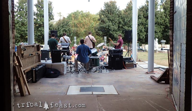 Behind the scenes at an Athens Porchfest show at a local artist's studio.